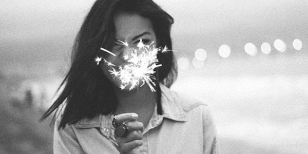 Woman with sparkler.